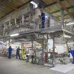 kernow coatings factory photo of large coating machine and workers
