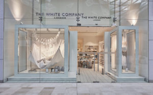 visual merchandising shop window display for The White Company with a white hammock