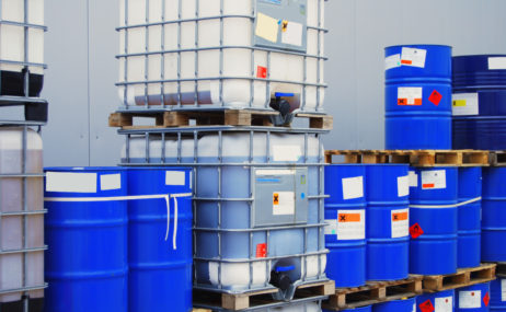 chemical containers with adhesive labels